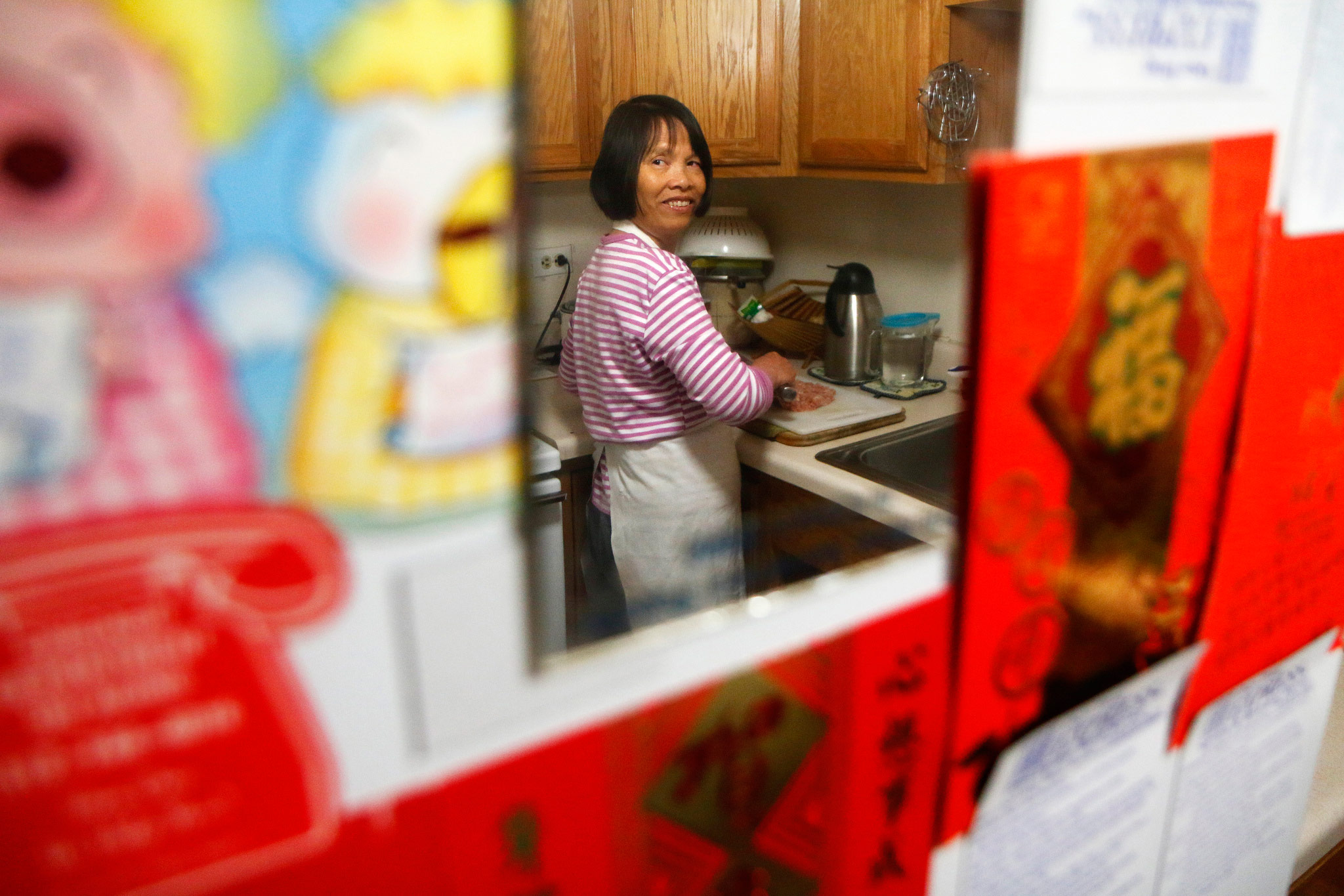 Cuihuan Yu A Home Assistant Cooks For Her Client 78 Year Old Tai Khuai Wah At S Apartment In Chicago Chinatown On May 10 2017