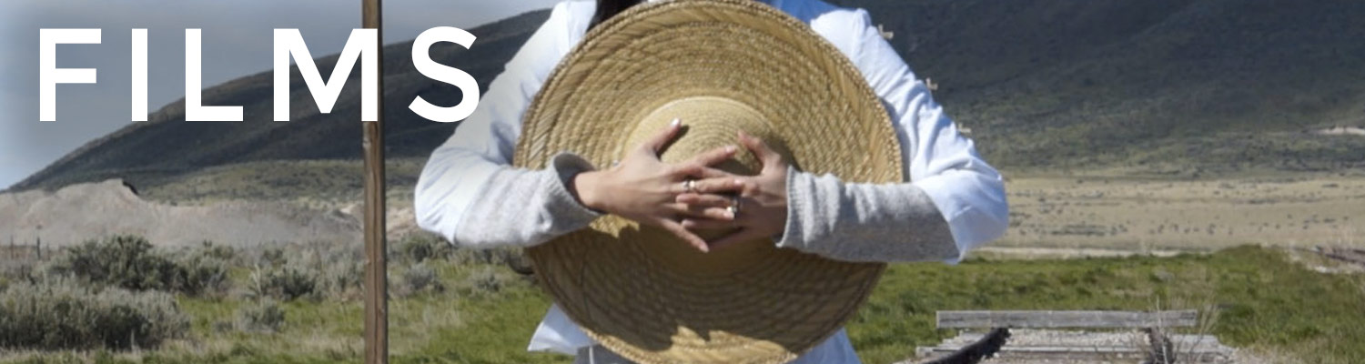"In the center, someone wearing a white sweater laces her fingers across her chest. You can only see from her shoulders to her waist; the rest has been cropped out. She is wearing rings on her middle fingers and her nails are polished. She is carrying a straw hat. Behind her is a wooden structure and a prairie-like environment with a mountain rising in the background. It is entitled ""Films."""