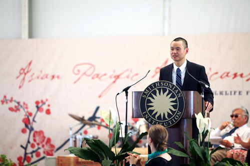Dr. Konrad Ng makes opening remarks at the Smithsonian Folklife Festival