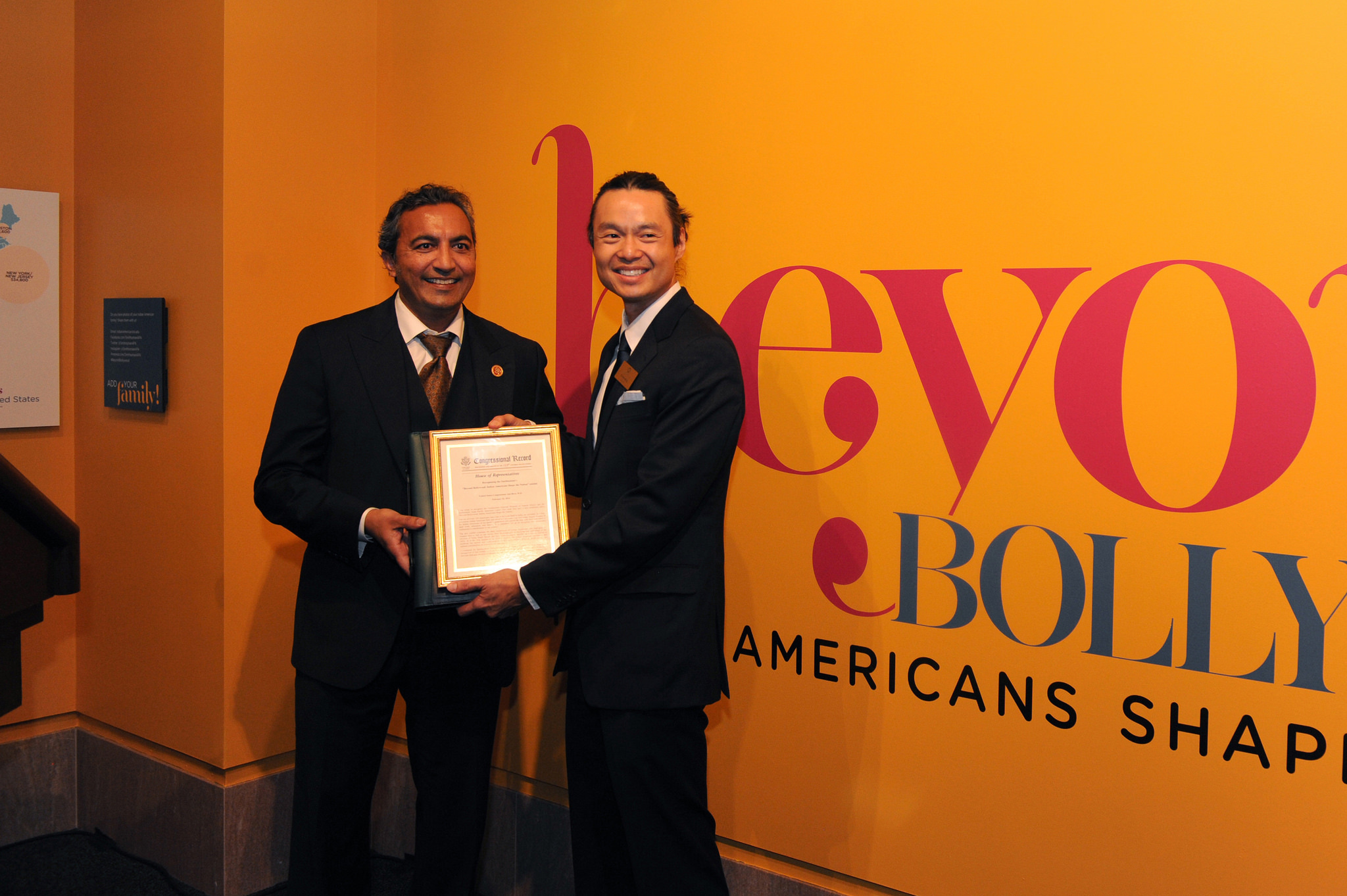 Congressman Ami Bera presents the US Congress's recognition of Beyond Bollywood: Indian Americans Shape the Nation</i> exhibition into the country's historical record.