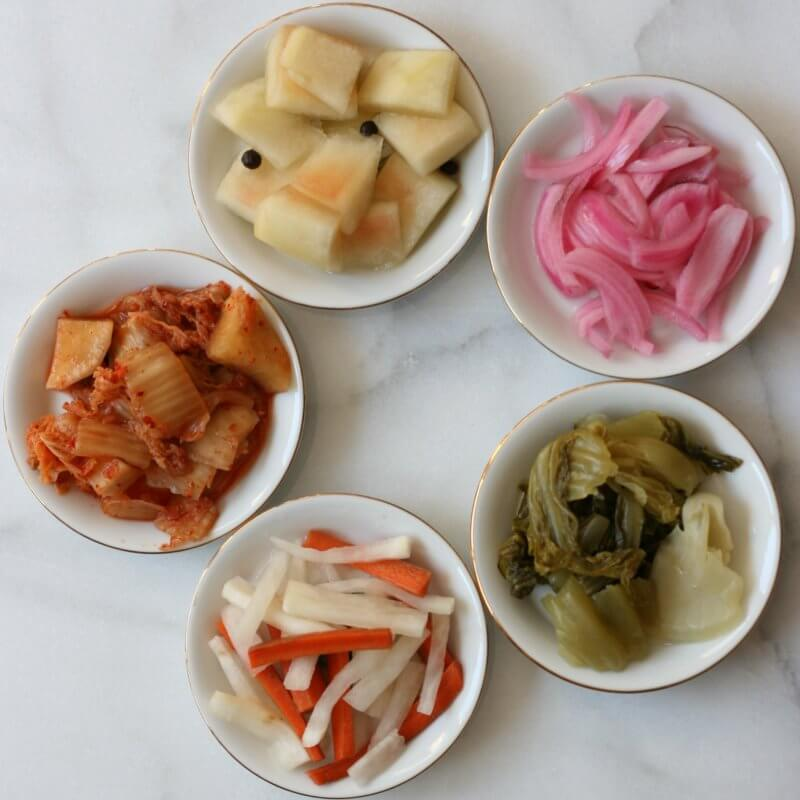 From top left, going clockwise: From top left, clockwise:  1. Watermelon 2. Red onion 3. Mustard cabbage 4. Carrot and daikon 5. Cabbage kimchi