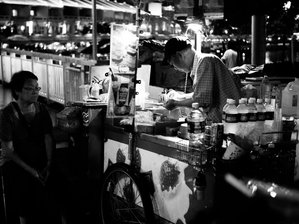 ice cream cart man and woman selling