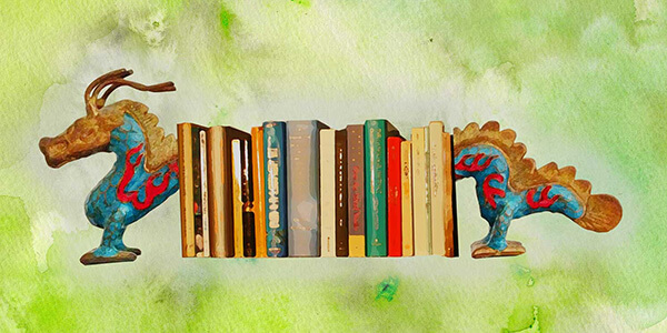 A watercolor painting of a bookshelf with dragon bookends.